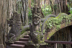 Famous dragon bridge in sacred monkey forest. In Ubud, Bali, Indonesia Royalty Free Stock Image