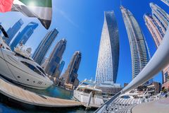 Dubai Marina with boats against skyscrapers in Dubai, United Arab Emirates Royalty Free Stock Photography