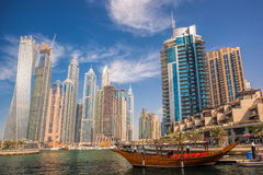 Dubai Marina with boats against skyscrapers in Dubai, United Arab Emirates Royalty Free Stock Image