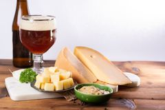 Famous Dutch finger food usually served with glass of beer, cube. S hard old Dutch cow and goat cheese with Dijon mustard royalty free stock photography