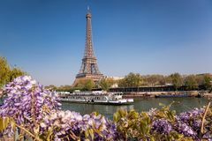 Eiffel Tower with boat during spring time in Paris, France. Famous Eiffel Tower with boat during spring time in Paris, France Royalty Free Stock Image
