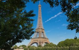 The Eiffel tower is the most popular travel place and global cultural icon of the France and the world. Stock Photo
