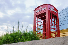 Famous English red telephone booth with cloudy day. Stock Photography
