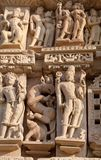 Famous erotic temple in Khajuraho, India. Ancient bas-relief at famous erotic temple in Khajuraho, India. Most Khajuraho temples were built between 950 and 1050 royalty free stock image