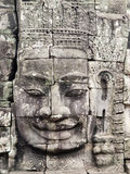 Famous face of Bayon Temple. Eye contact with the famous smiling face at Bayon temple in Cambodia Stock Photography