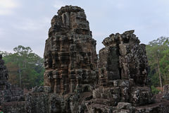 The famous `face towers` of the  Bayon-temple in Angkor, Cambodia. Smiling face in the temple of Bayon, Angkor Wat, Siem Riep, Cambodia Royalty Free Stock Photo