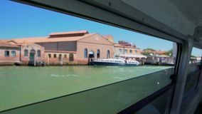 Famous faro di Murano lighthouse, view through water bus window, trip to Venice. Stock footage stock video footage