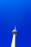 Fernsehturm TV tower in Berlin. The famous Fernsehturm television broadcasting tower at Alexanderplatz in downtown Berlin, Germany Royalty Free Stock Image