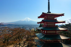 The famous five-storied Chureito Pagoda stands in front of Mount Fuji on a warm spring d royalty free stock images