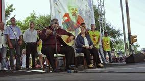 Famous folk singers Arif Sag and Sabahat Akkiraz singing at Alevi peoples meeting stock video footage