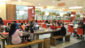 Famous food attracts people. Groups of people gather and eat together in food court Malaysia Stock Photo