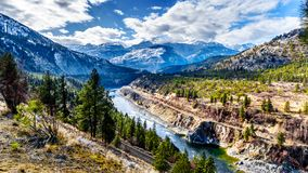 The famous Fraser Canyon Route following the Thompson River as it flows through the snow covered mountains of the Coastal Mountain. Range in western British Royalty Free Stock Photo