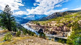The famous Fraser Canyon Route following the Thompson River as it flows through the snow covered mountains of the Coastal Mountain. Range in western British Stock Photography