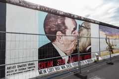 The famous Fraternal kiss graffiti: My God, Help Me to Survive This Deadly Love by Dmitri Vrubel on the Berlin Wall in. BERLIN, GERMANY- Sep 28, 2016: The famous royalty free stock photo