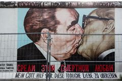 The famous Fraternal kiss graffiti: My God, Help Me to Survive This Deadly Love by Dmitri Vrubel on the Berlin Wall in. BERLIN, GERMANY- Sep 28, 2016: The famous royalty free stock image