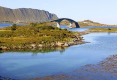 Famous fredvang bridges in autumn with mountains in backgrond and beautiful blue fjord in foreground , lofoten islands, norway. Panoramic view of famous fredvang Stock Images