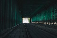 Famous Gdański bridge in Warsaw. Green tunnel and tram rails on Gdański bridge. Warsaw, Poland Stock Photos