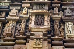 Close up genre stone carving in Lakshman Temple. Famous genre bas relieves, Lakshmana Temple, Khajuraho, India. Unesco World Heritage Site. The most famous Royalty Free Stock Image