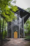 Famous glass chapel in the woods. Famous Thorncrown Chapel in the woods of Eureka Springs Stock Images