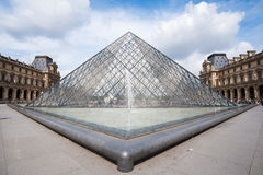 The famous glass pyramid of louvre museum. The glass pyramid, which is designed by a famous architect, is one of the logos of paris Royalty Free Stock Images