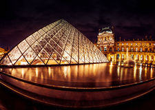 The famous glass pyramid at the Louvre museum Stock Photo