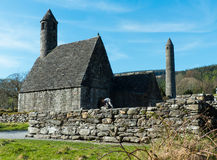 The famous Glendalough Monastic site with its round tower and cemetery in the Wicklow mountains in County Wicklow,. This historic site dates back to 6th century Royalty Free Stock Photos
