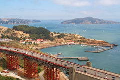 Famous Golden Gate Bridge and ship port in San Francisco Stock Images
