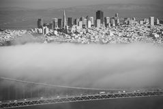 Golden Gate bridge span and cables on foggy day view from Marin. Famous Golden Gate bridge span and cables on foggy day view from Marin Headland San Francisco royalty free stock images