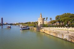 The famous Torre del Oro, the Moorish tower built to defend Sevi. The famous Golden tower, Torre del Oro, along the Guadalquivir river, the Moorish tower built Royalty Free Stock Images
