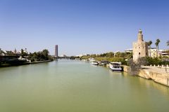 The famous Torre del Oro, the Moorish tower built to defend Sevi. The famous Golden tower, Torre del Oro, along the Guadalquivir river, the Moorish tower built Stock Photo