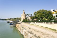 The famous Torre del Oro, the Moorish tower built to defend Sevi. The famous Golden tower, Torre del Oro, along the Guadalquivir river, the Moorish tower built Stock Photos