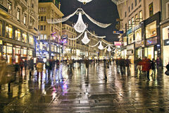 Famous Graben street by night with people and reflections Royalty Free Stock Photo