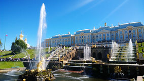 The famous Grand Palace of Peterhof and the group of amazing fountains cascade in front of it. Stock Photography