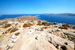 Famous   in  greece the historycal acropolis ruin site. In delos         greece the historycal acropolis and         old ruin site Royalty Free Stock Image