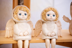 Famous handicraft mart Kaziukas in Vilnius, Lithuania: a pair of blue-eyed angels. Famous handicraft mart Kaziukas in Vilnius, Lithuania: a pair of beautiful Royalty Free Stock Image