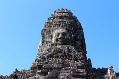 Famous head statues of ancient Bayon temple Royalty Free Stock Photo