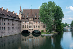 The `Heilig Geist Spital` in the middle of the old town of Nuremberg, Germany Stock Images
