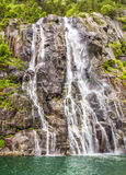 Famous Hengjanefossen waterfall coming down from a steep rock face into Lysefjord. Royalty Free Stock Image