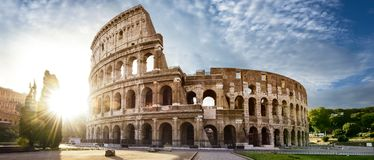 Colosseum in Rome and morning sun, Italy. Famous historic Colosseum in Rome and morning sun, old civilisation, Italy royalty free stock image