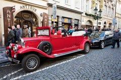 Famous historic red car Praga in Prague street. PRAGUE, CZECH REPUBLIC - DECEMBER 3, 2016: Famous historic car Praga at street in advent christmas time. Praga is Stock Images