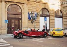 Famous historic red car Praga in Prague street. PRAGUE, CZECH REPUBLIC - DECEMBER 3, 2016: Famous historic car Praga at street in advent christmas time. Praga is Stock Photos