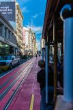 Famous Historic traditional cable car in San Francisco. Go on the rail with passenger royalty free stock image