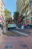 Famous Historic traditional cable car in San Francisco. With passenger stock photo