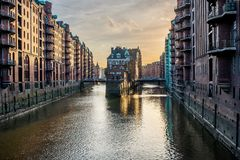 Famous historic warehouse district Speicherstadt in Hamburg, Germany in evening sunlight Royalty Free Stock Photo