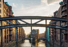 Famous historic warehouse district Speicherstadt in Hamburg, Germany in evening sunlight Stock Photos