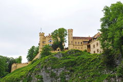Famous Hohenschwangau Castle on top of hill Royalty Free Stock Photo