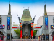 Famous Hollywood Grumman's Chinese Theatre. Entrance to Grumman's Chinese Theatre and the world famous star studded footprints and handprints with celebrity Royalty Free Stock Photography