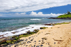 Famous Hookipa beach, popular surfing spot filled with a white sand beach, picnic areas and pavilions. Maui, Hawaii. Royalty Free Stock Image