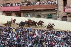 The famous horse race `Palio di Siena` stock photos