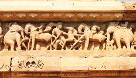 Famous human and animals sculptures at temple in Khajuraho, Indi. A. UNESCO world heritage site Stock Photo
